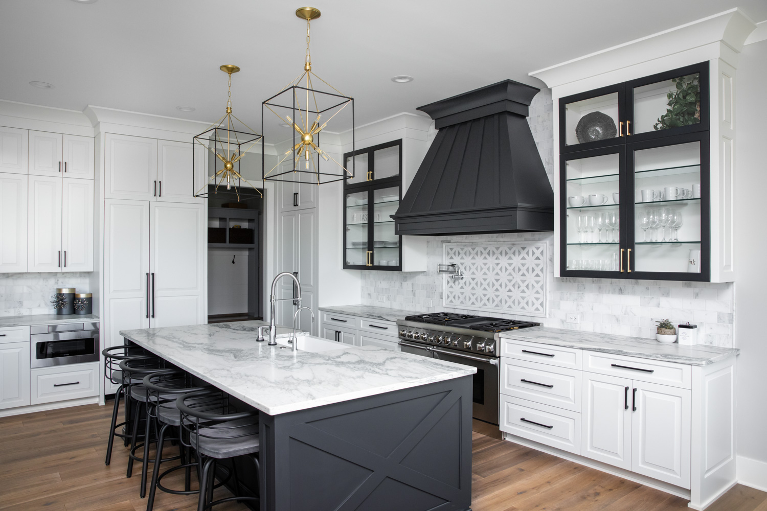 black and white kitchen, white kitchen, custom kitchen, kitchens of instagram, two toned cabinets, wood range hood, brass hardware